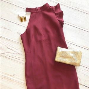 Boutique Berry cocktail dress with ruffled arm